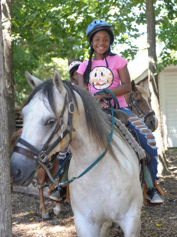Grey Horse Ridden by Little Girl in Raleigh